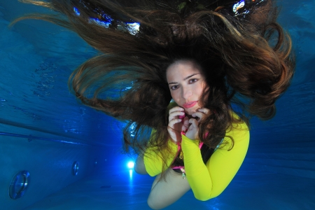 long life: Woman underwater Stock Photo