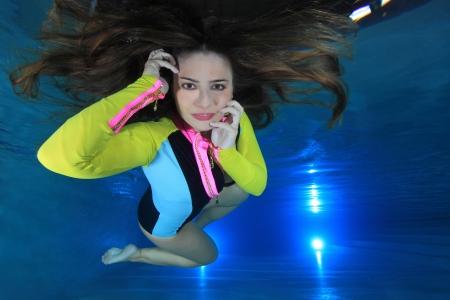 Woman underwater photo