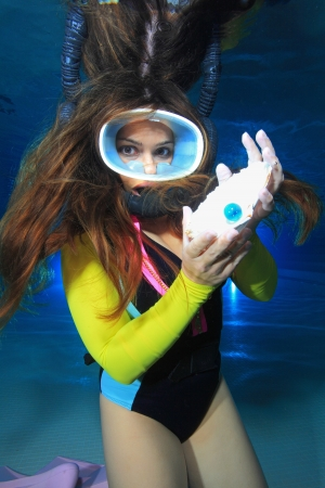 Female scuba diver and pearl photo