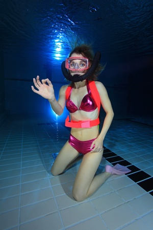 woman diving: Female diver show hand signal  Stock Photo