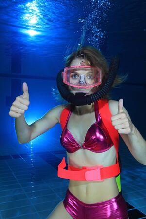 regulator: Female diver show hand signal  Stock Photo