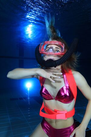 drowning: Female scuba diver out of air