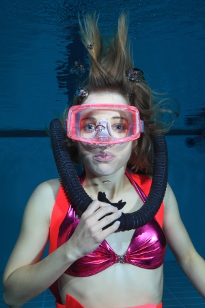 Female scuba diver out of air