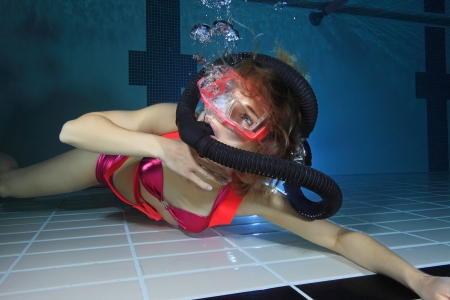 Female scuba diver out of air  photo