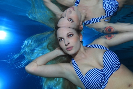 Woman underwater in the pool  photo