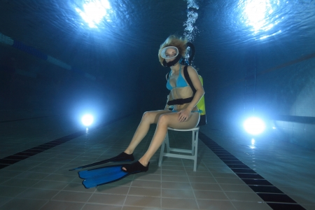 Female diver sitting on chair