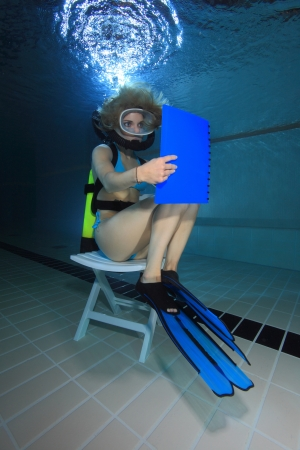 Female diver reading underwater  Stock Photo