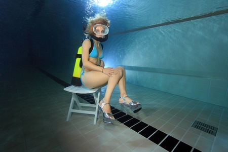 scuba: Female diver sitting on chair