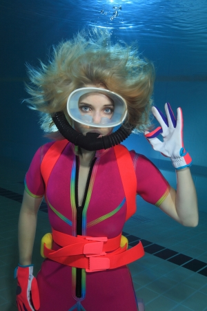 Female scuba diver show hand signal  photo