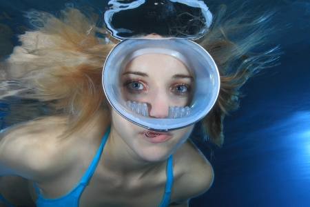 Female diver with round dive mask  photo