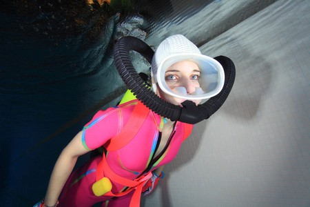 Female scuba diver with bathing cap   photo