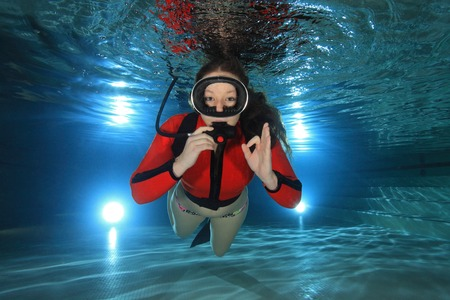 scuba woman: Scuba woman with red neoprene suit in the pool  Stock Photo