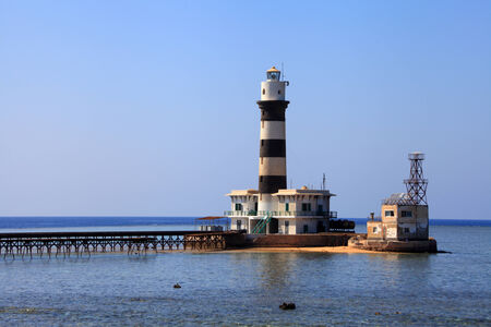dangerous reef: Lighthouse of the Daedalus reef in the red sea Stock Photo