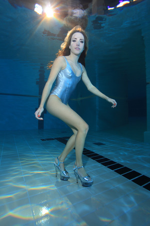sporting activity: Underwater model with high heels