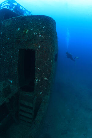 Shipwreck in the waters of the mediterranean sea photo