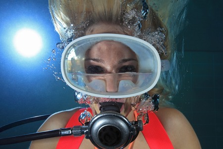 submerge: Scuba diver underwater with water inside mask