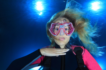 Female scuba diver show signal out of air  Stock Photo