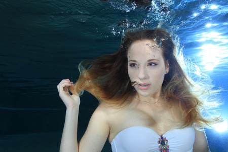 Young woman underwater photo
