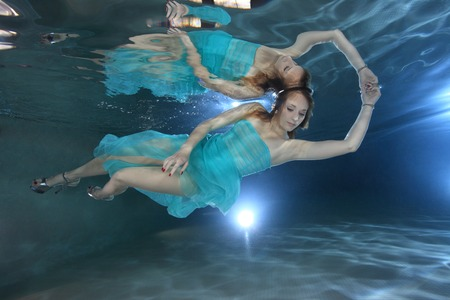 wet suit: Woman with dress posing underwater