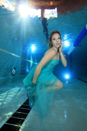 Woman with dress posing underwater  photo
