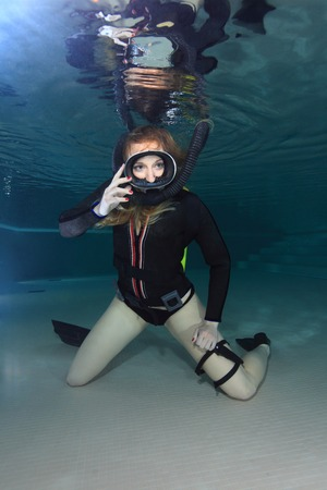 Scuba woman with black neoprene dress  photo