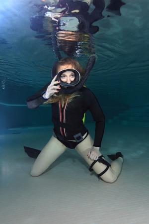 submerge: Scuba woman with black neoprene dress  Stock Photo