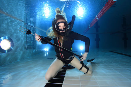 Scuba woman with spear gun photo