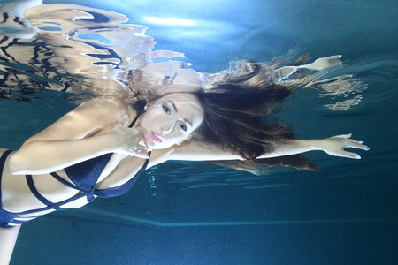 Beautiful woman underwater in the pool  photo