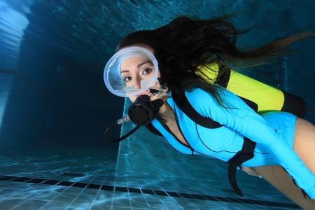 Female scuba diver with  suit underwater  photo