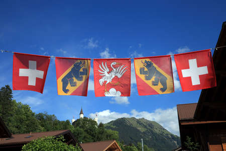gstaad: Flags of Switzerland, Bern and Gstaad Stock Photo