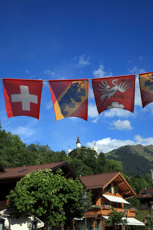 Flags of Switzerland, Bern and Gstaad Stock Photo