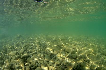 immersed: Gravel bottom of freshwater lake near the surface Stock Photo