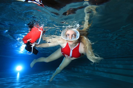 diving save: Lifeguard with red swimsuit and diving mask