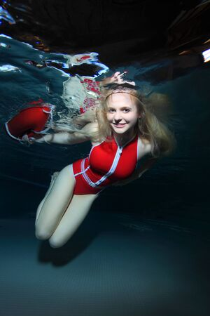 diving save: Lifeguard with red swimsuit and safety buoy Stock Photo