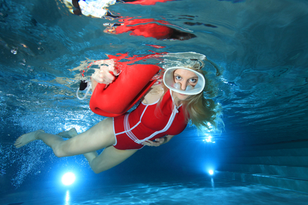 Lifeguard with red swimsuit and diving mask