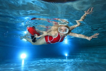 lifesaving: Lifeguard with red swimsuit and diving mask