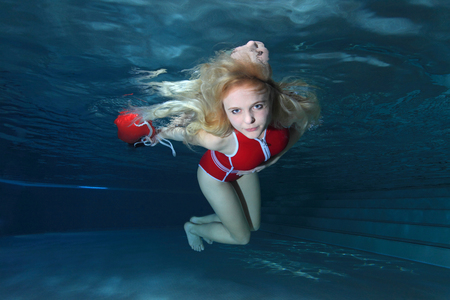 drowning: Lifeguard with red swimsuit and safety buoy Stock Photo