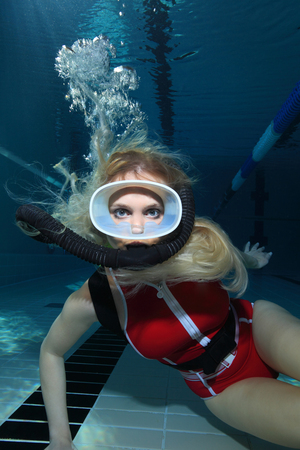 Close up of female scuba diver photo