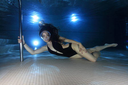 woman diving: Female diver with dive mask Stock Photo