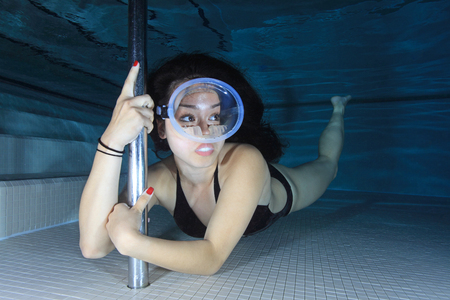 diving pool: Female diver with dive mask Stock Photo