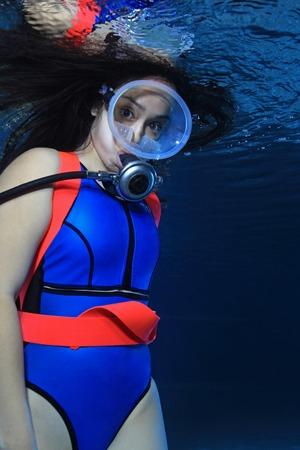 underwater sport: Female scuba diver