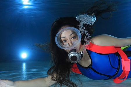 diving pool: Female scuba diver