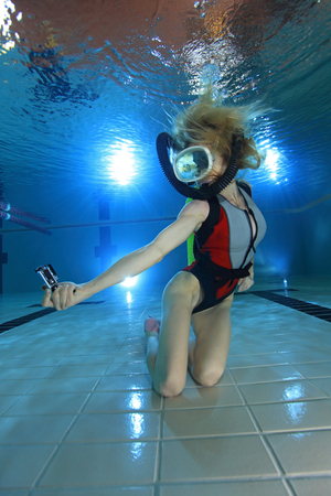 action movie: Female scuba diver with camera action Stock Photo
