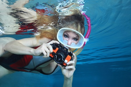 monokini: Sexy female snorkeler with underwater camera