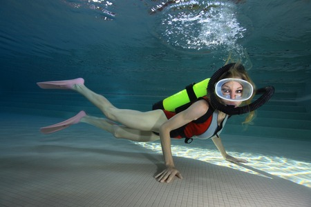 diving pool: Female scuba diver with neoprene swimsuit
