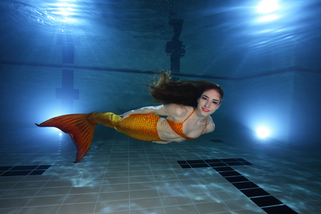 Mermaid swimming underwater