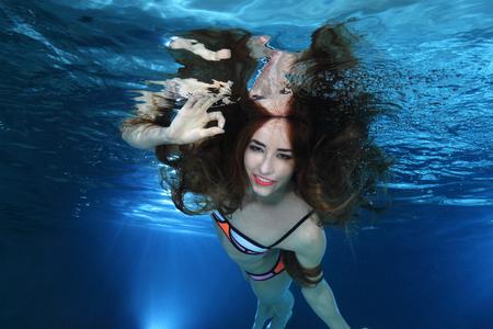 underwater woman: Woman swimming underwater