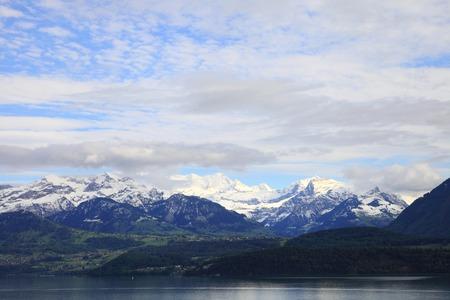 discreet: Lake of Thun and snowy mountains, Switzerland
