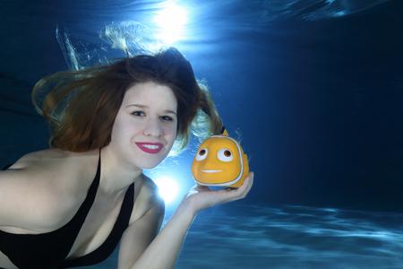 nemo: Beautiful woman with Nemo fish underwater