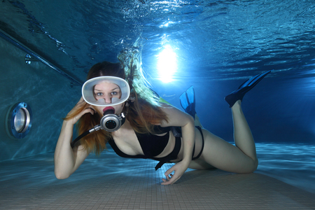diving pool: Female scuba diver with swimsuit underwater Stock Photo
